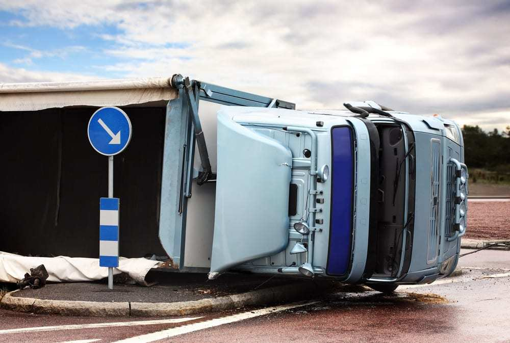 Semi truck on its side after a crash