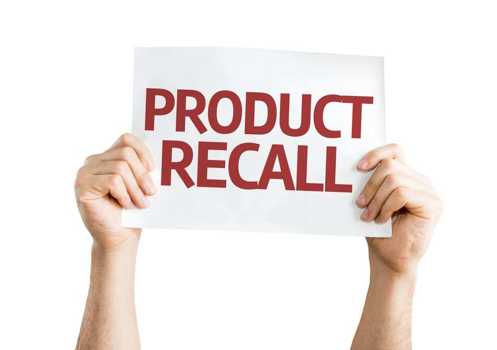 "Hands holding up paper reading ""Product Recall"""