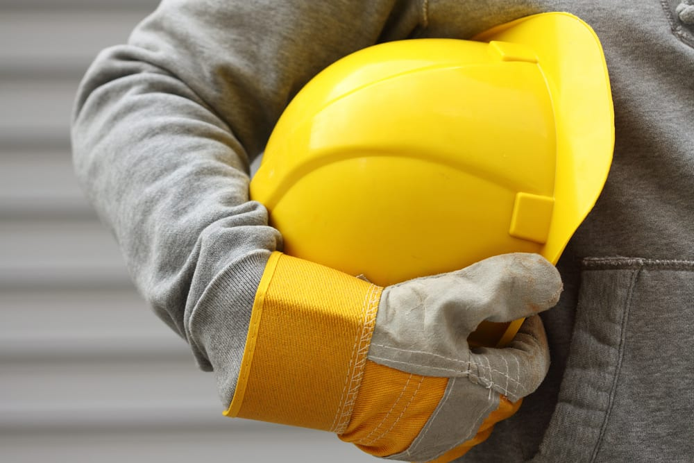 Construction worker holding hat close-up