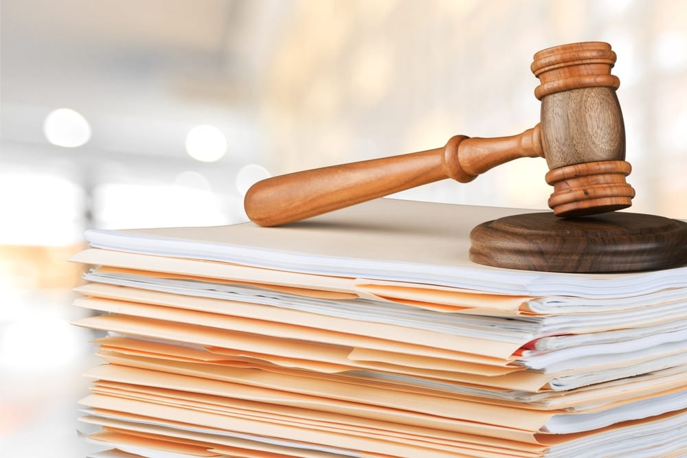 Gavel sitting atop stack of folders and documents