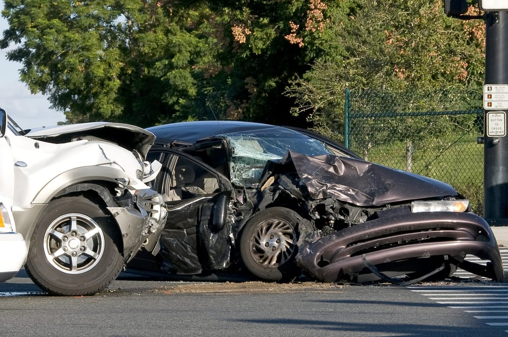two damaged vehicles in the aftermath of an auto accident
